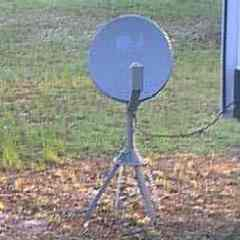 Satellite Dish for an RV is mounted on a movable tripod they can take with them when traveling.